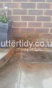 damp bricks caused from leaking gutter