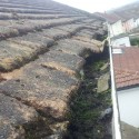 roofline and gutter with tiles slipped and resting in guttering