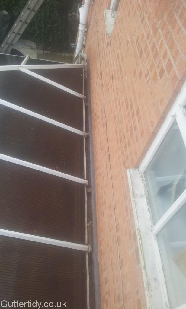 As the conservatory panes hang over the gutter, dirt accumulates underneath - so difficult to clear!