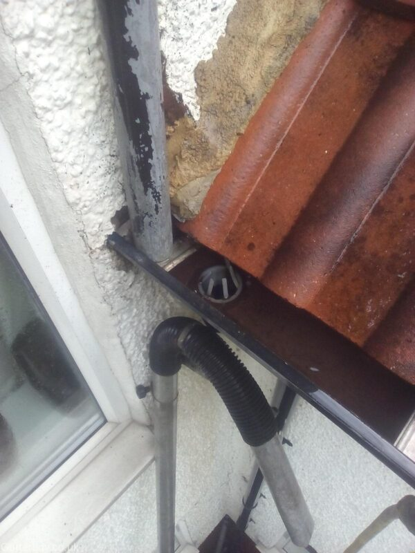 Aluminium gutter which has been cleared and flushed clean.